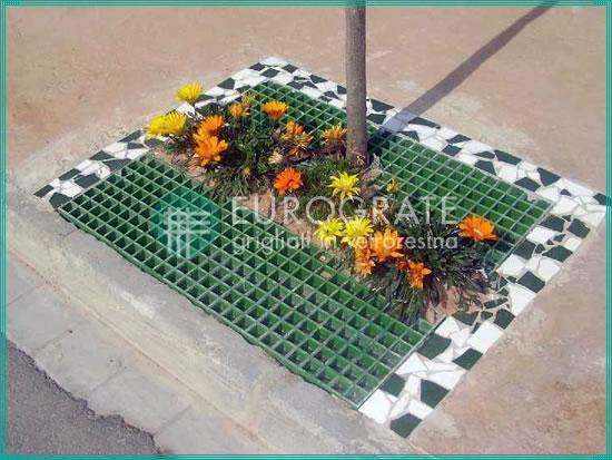 rejillas y flores como diseño ornamental para cubrir un agujero